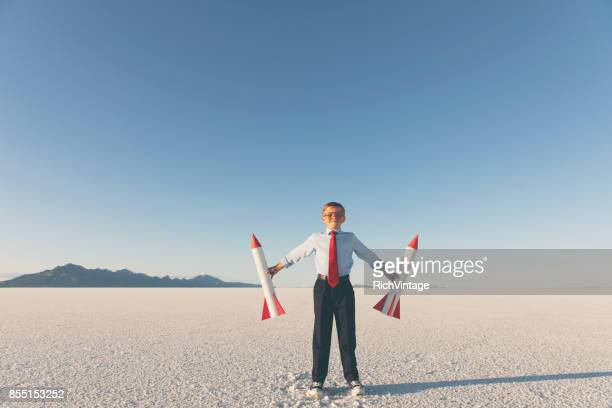 Business Boy Holding Rockets