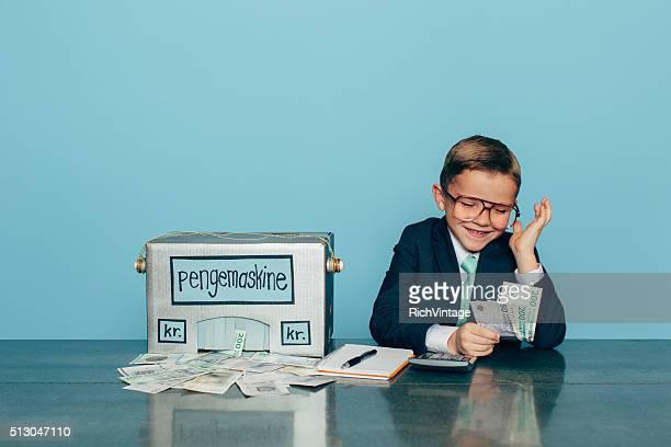 Business Boy is Happy with Danish Money Making Machine