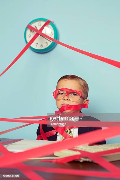 Business Boy Tied Up in Red Tape