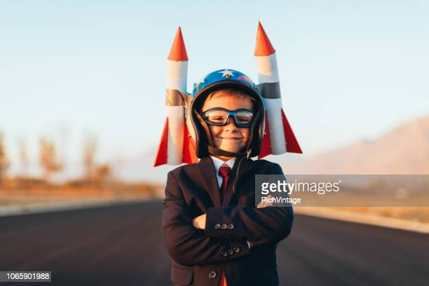 Business Boy with Rockets on Helmet