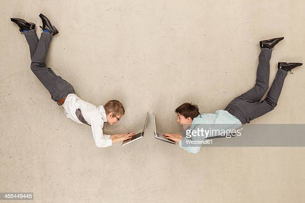 Business boys using laptop