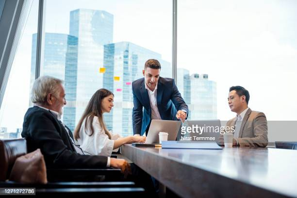 business brainstorming. business development manager giving ideas to business people at meeting in big conference room. global business, multi-ethnic professional teamwork. - opening event stock pictures, royalty-free photos & images