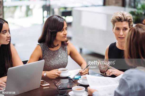 business brunch with colleagues in modern concept bar - only women stock pictures, royalty-free photos & images