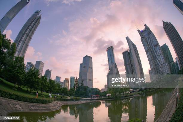 Business buildings around the Lujiazui central park in lujiazui financial center, Shanghai, China