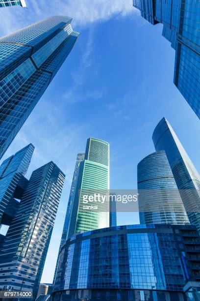 business buildings under clear blue sky - moscow international business center stock photos and pictures