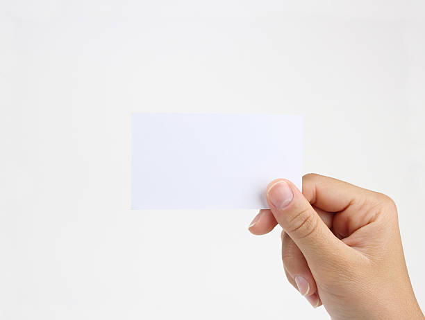 business card in hand - human hand stock pictures, royalty-free photos & images