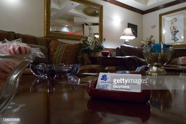Business cards sit on a coffee table in the parlor of the Chicken Ranch brothel in Pahrump Nevada US on Thursday Jan 26 2012 The Nevada Republican...