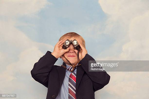Business Child Looks For Profits Through Binoculars