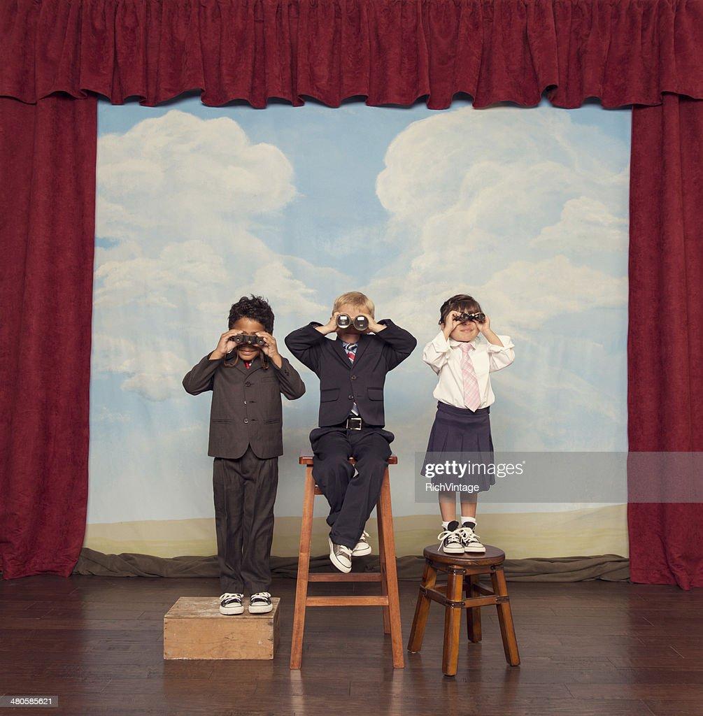 Business Children Looking For Profits Through Binoculars : Stock Photo