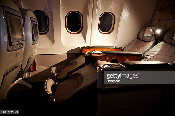 business class reclined seats of airplane - seat stock pictures, royalty-free photos & images