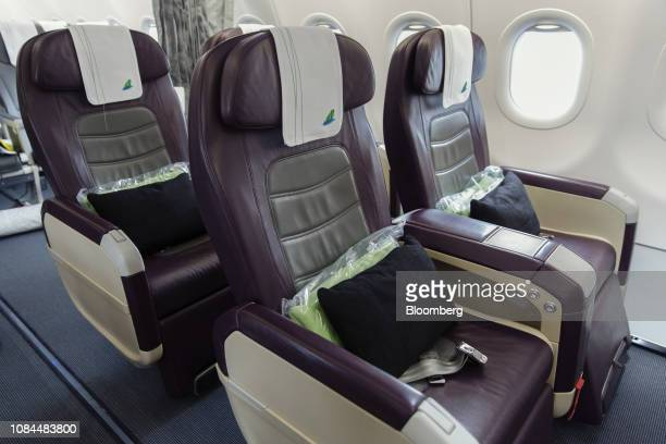 Business class seats are seen on board an Airbus SE A321 Neo aircraft operated by FLC Group JSC's Bamboo Airways on the first day at the airline's...