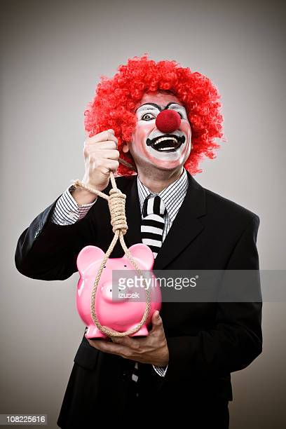 Business Clown With Piggy Bank