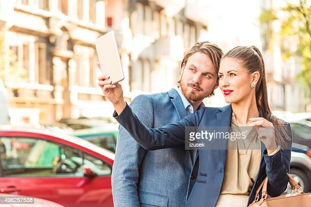 business colleague taking selfie on the street - izusek stock pictures, royalty-free photos & images