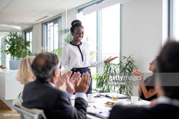 business colleagues applauding successful presentation - applauding stock pictures, royalty-free photos & images