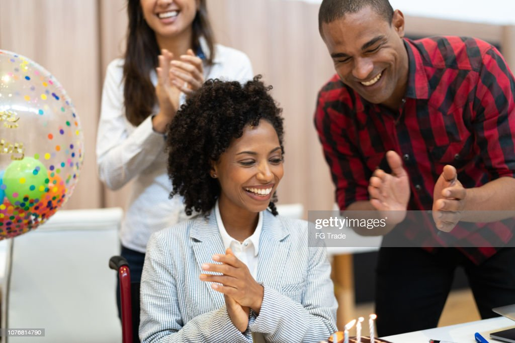 Business colleagues celebrating birthday party at work : Stock Photo