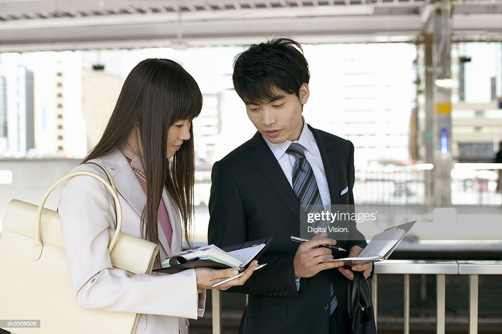 Business Colleagues Checking Each Others Diaries : Stock Photo