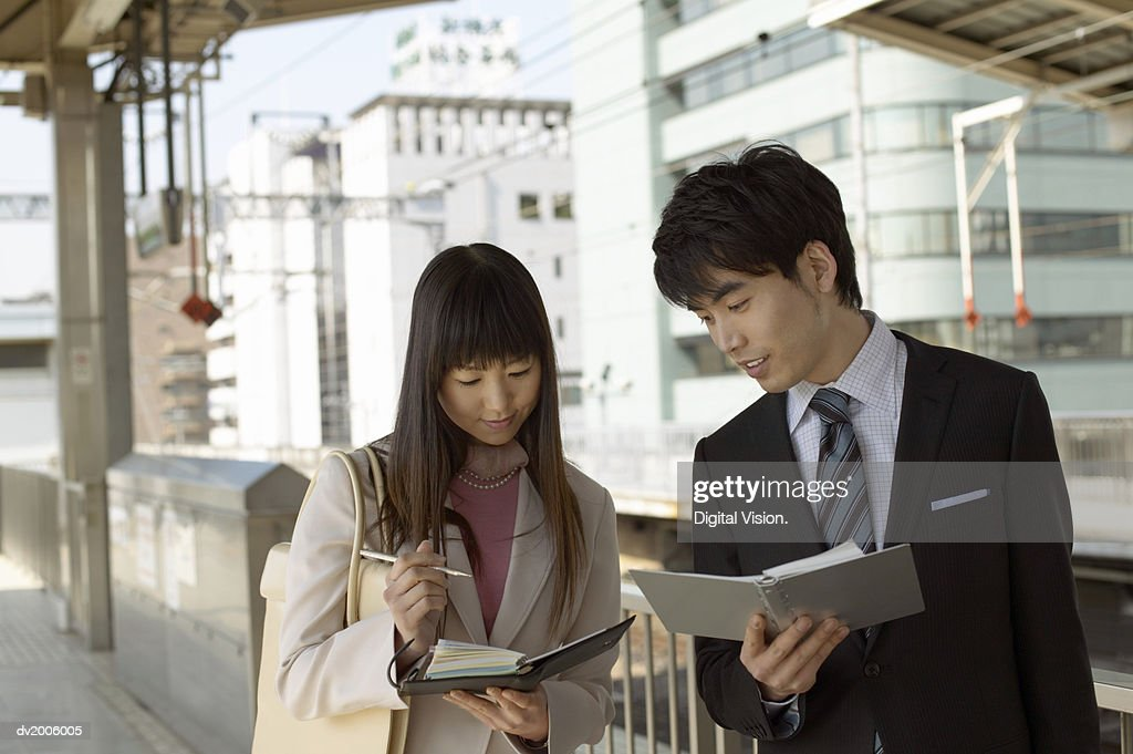 Business Colleagues Checking their Diaries : Stock Photo