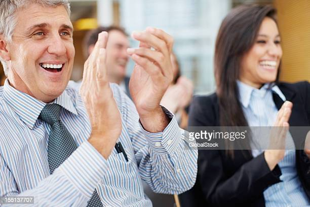 Business colleagues clapping and cheering