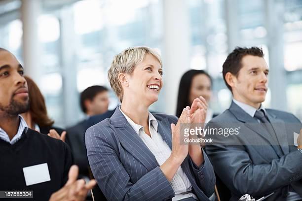 business colleagues clapping her hand while at a seminar - award stock pictures, royalty-free photos & images