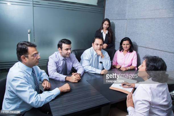business colleagues discussing a project - 30 39 years stock pictures, royalty-free photos & images
