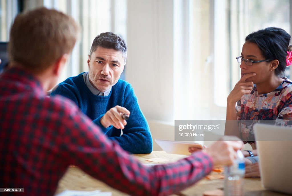 Business colleagues discussing a project : Stock Photo