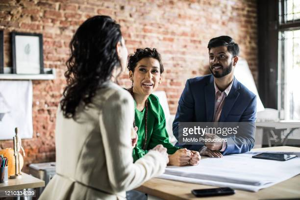 Business colleagues discussing architecture project in office
