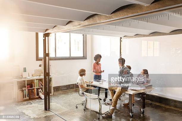 business colleagues discussing in board room - leanincollection stock pictures, royalty-free photos & images