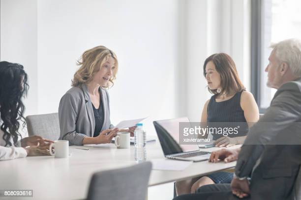 Business colleagues discussing in board room