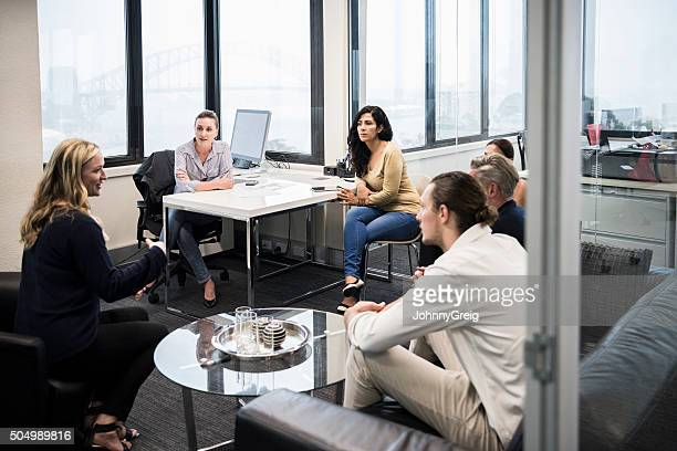Business colleagues discussing in meeting in modern office