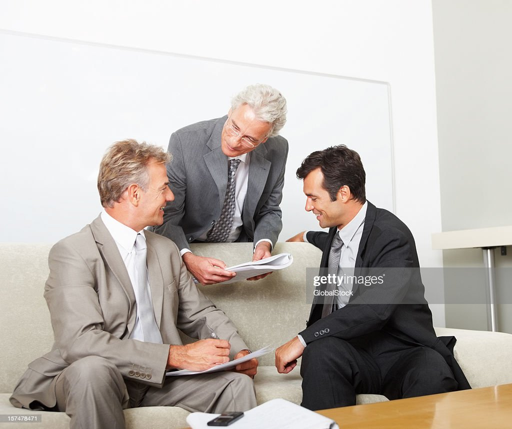 Business colleagues discussing in meeting : Stock Photo