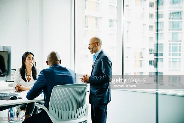 Business colleagues discussing project in office