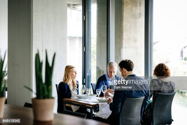 Business Colleagues Eating Together At Restaurant