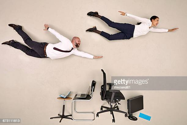 Business colleagues flying over chairs and devices