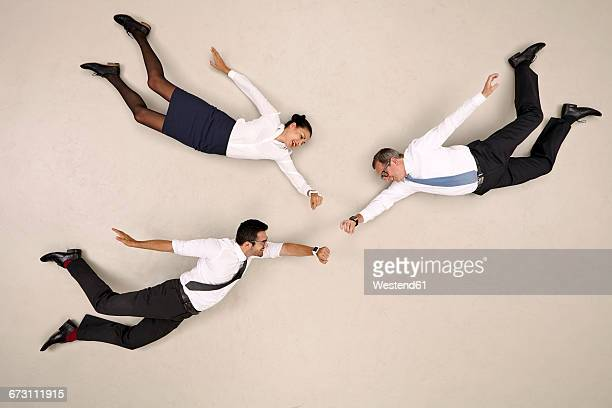 business colleagues flying with smartwatches - hovering stock pictures, royalty-free photos & images