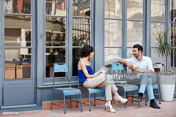 Business colleagues having a coffee break outside