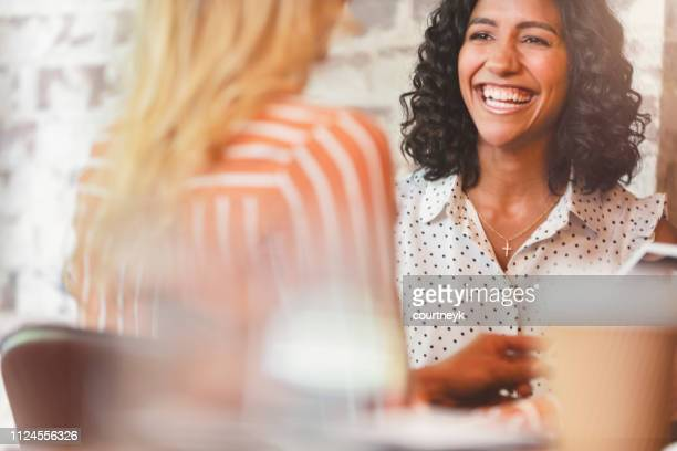 business colleagues having a conversation. - employee stock pictures, royalty-free photos & images
