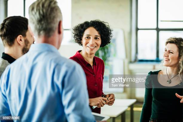 business colleagues having meeting together at office - casual clothing stock pictures, royalty-free photos & images