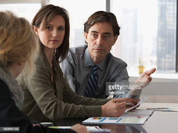 business colleagues in a meeting - american influenced stock photos and pictures
