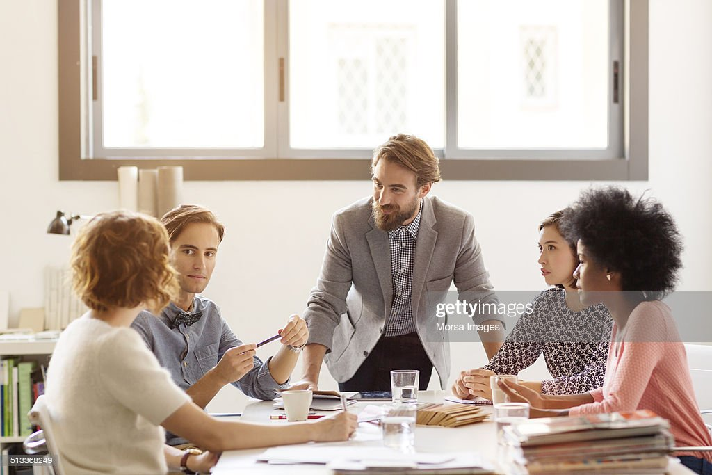 Business colleagues in board room : Stock Photo