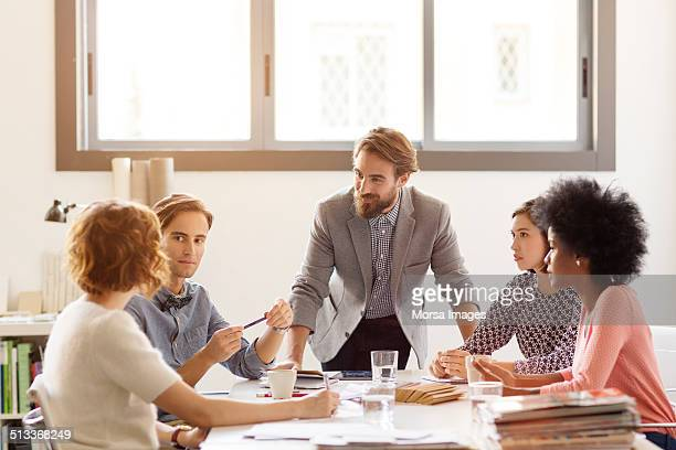 Business colleagues in board room