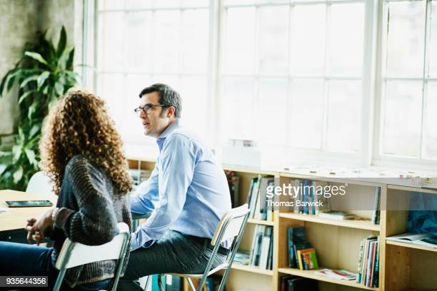 Business colleagues in discussion at office conference table