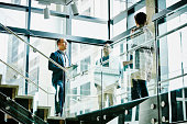 Business colleagues in discussion on office stairs