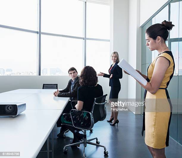 Business colleagues in meeting in conference room