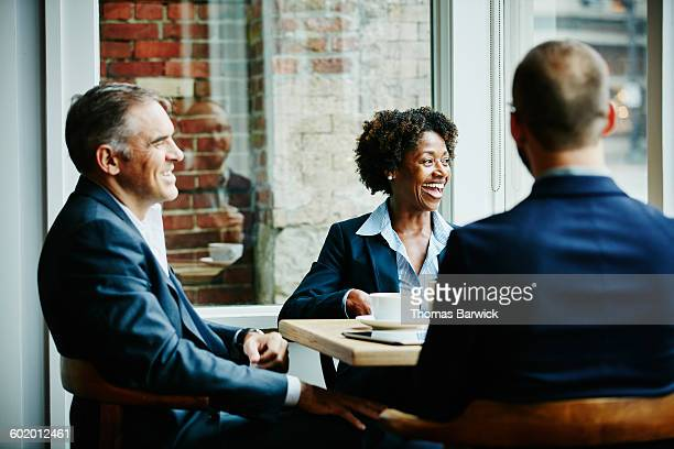 Business colleagues laughing during meeting
