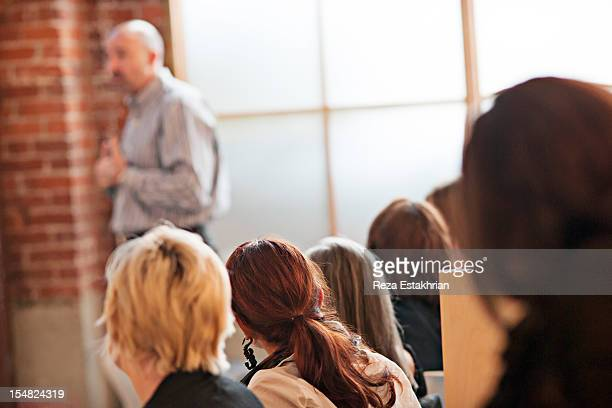 Business colleagues listen to presentation