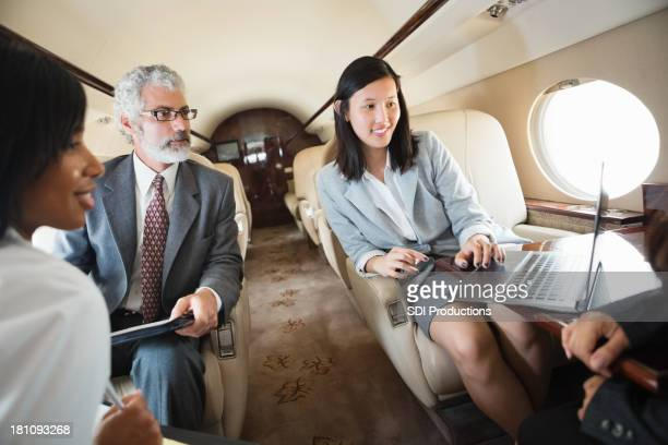 Business colleagues meet on board a private jet