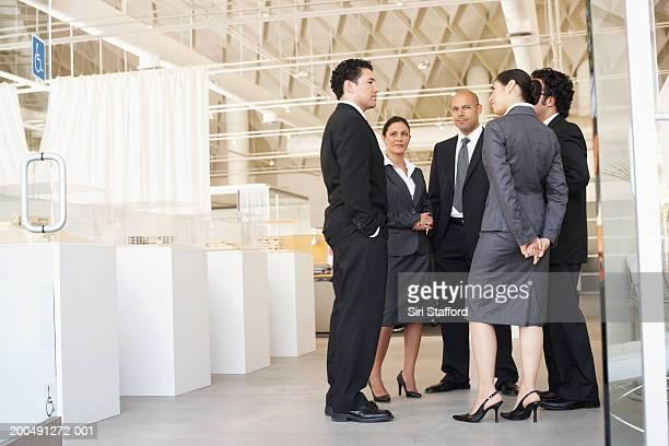 Business colleagues meeting by doorway