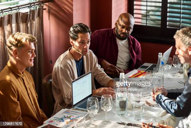 business colleagues meeting in restaurant with laptop - lunch stock pictures, royalty-free photos & images