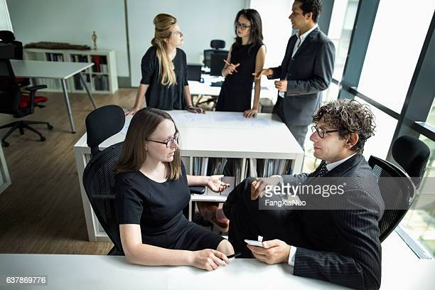 business colleagues meeting together in planning office - real estate office stock photos and pictures