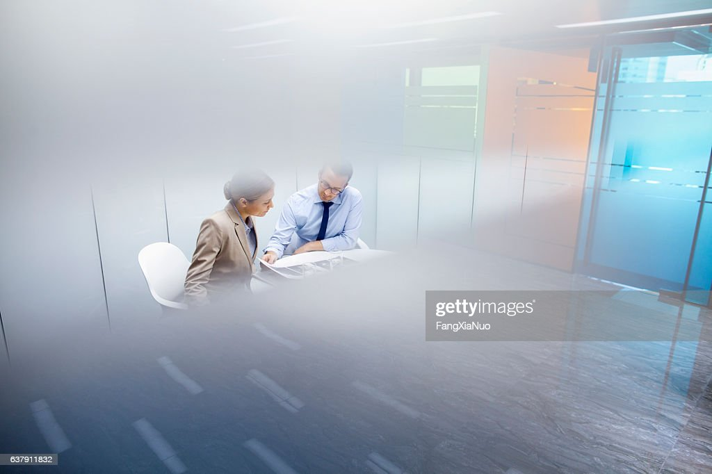 Business colleagues meeting together in room : Stock Photo